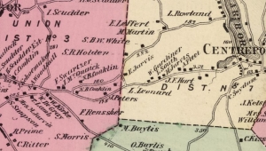 A section of the 1873 map of Huntington showing the new road to Centerport's grist mill starting near the house of N.B. Conklin.