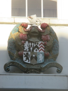 The Cromwell family Coat of Arms.  the lion rampant at the top was used in the Town of Huntington's Coat of Arms prepared in for the U.S. Bicentennial.  The town's coat of arms is no longer used in light of its association with Oliver Cromwell, who has been accused of genocide in connection with his actions in Ireland.
