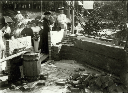 Emma Paulding, the school's director, lays the cornerstone for the new building , August 10, 1905