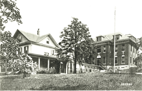 The house on the property and the new brick hospital building.