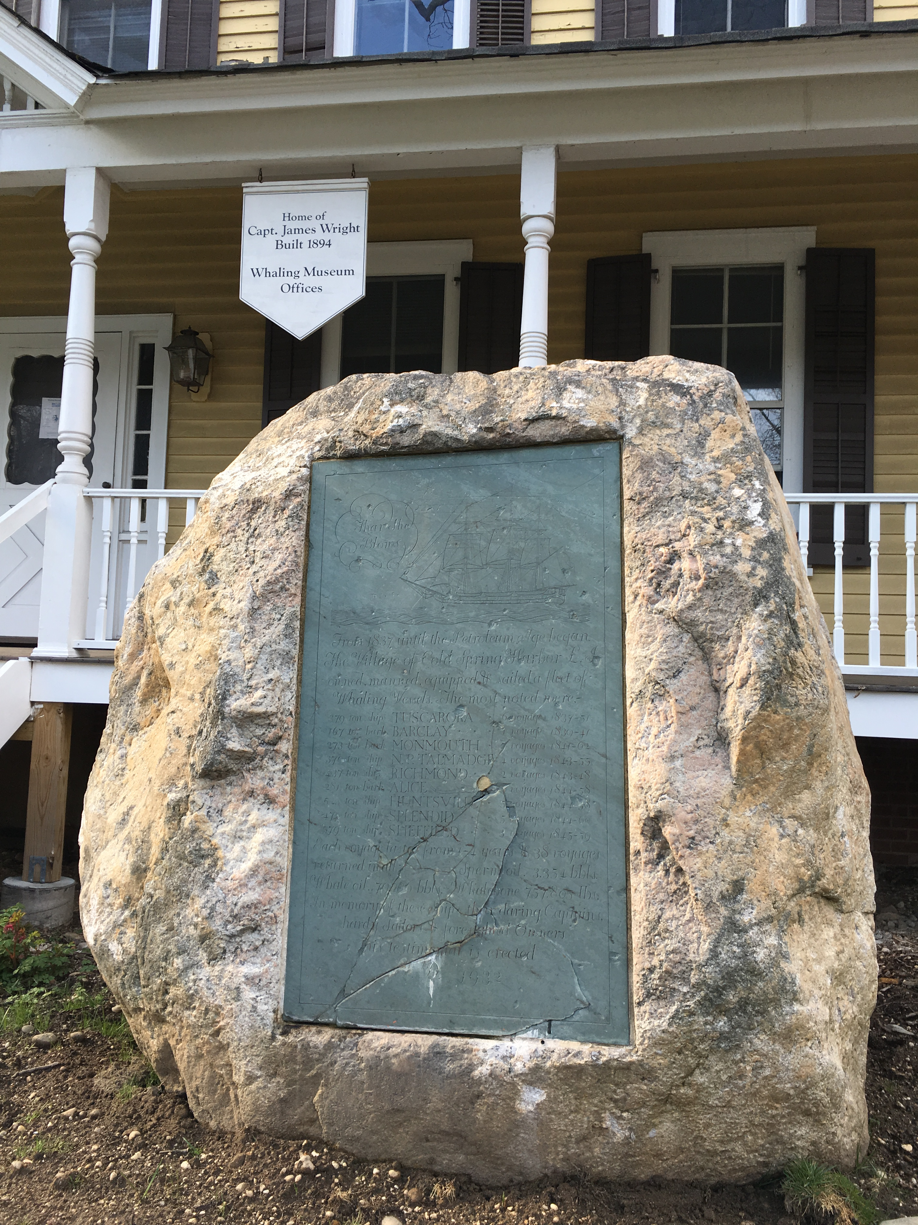 This boulder was dredged from the bottom of Cold Spring Harbor. It was originally placed in front of the odl Cold Spring Harbor library on Shore Road to commemorate the hamlet's whaling history. When the library moved from that location in the 1980s, the boulder was moved to the Whaling Museum.