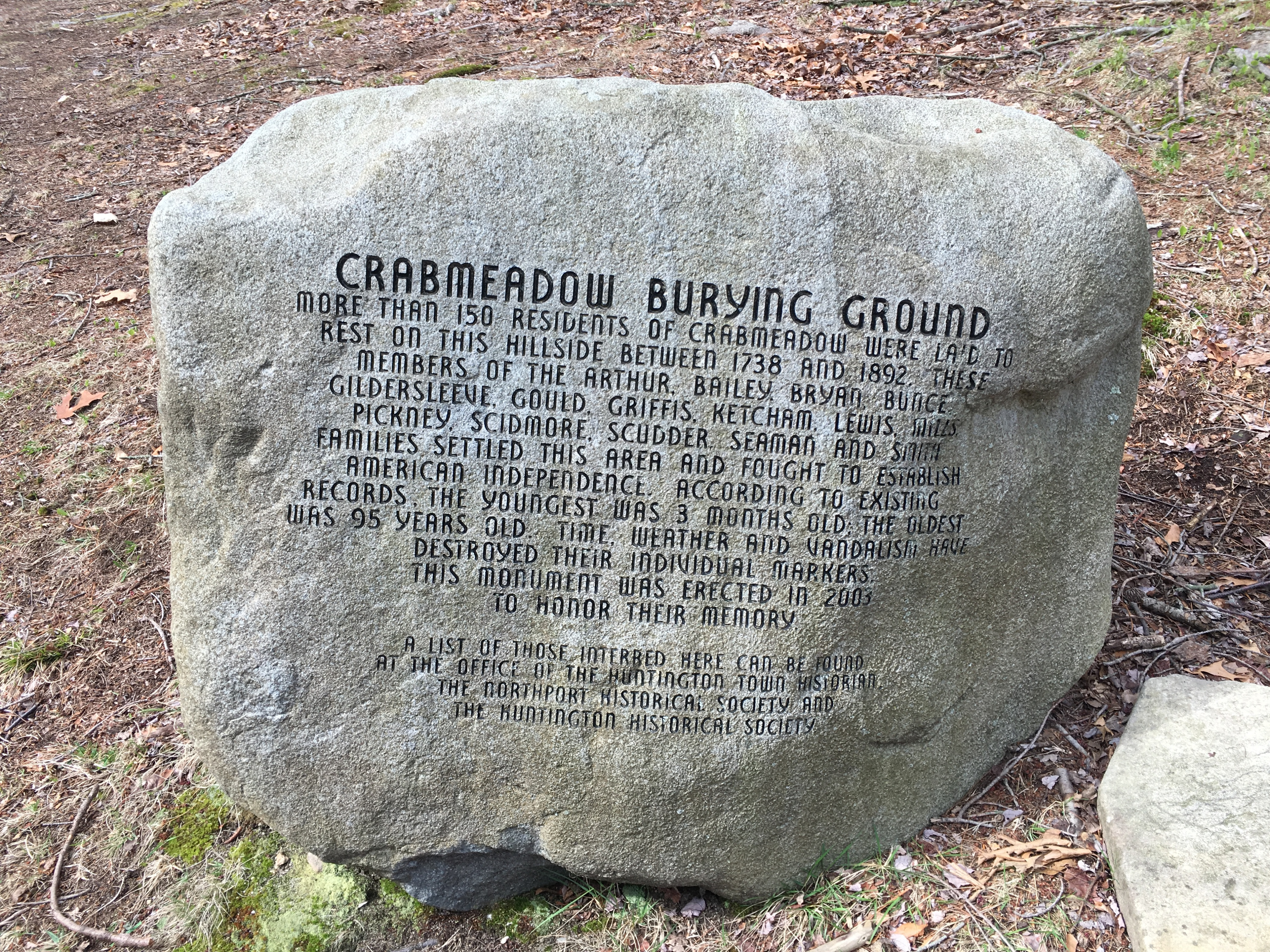 The eighteenth century burying ground in Crabmeadow has lost most of its grave markers to time, neglect, and vandalism. In 2003, this boulder was installed to replace the missing individual markers.